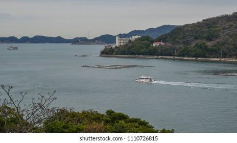 Kumano, Japan - Mar 18, 2018. Speedboat running on blue sea at summer day in Kumano, Japan.