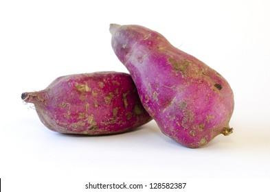 Kumara - Japanese sweet potato isolated on a white background.