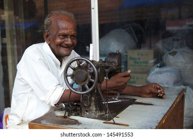 KUMARAKOM, KERALA, INDIA - MAY 1 - A tailor working in Kumarakom, Kerala on May 1, 2013. The town is a popular tourism destination famous for fishing, agriculture and backwaters of the Vembanad Lake.