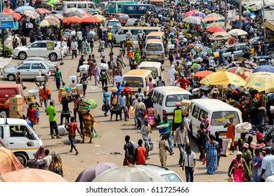 KUMASI, GHANA - JAN 15, 2017: Unidentified Ghanaian people buy and sell goods at the Kumasi market. Ghana people suffer of poverty due to the bad economy.