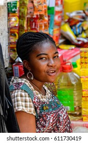 KUMASI, GHANA - JAN 15, 2017: Unidentified Ghanaian girl with braids looks ahead at the Kumasi market. Ghana people suffer of poverty due to the bad economy.