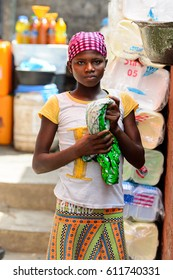 KUMASI, GHANA - JAN 15, 2017: Unidentified Ghanaian woman holds a rag at the Kumasi market. Ghana people suffer of poverty due to the bad economy.