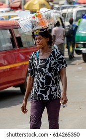 KUMASI, GHANA - JAN 15, 2017: Unidentified Ghanaian woman walks at the Kumasi market. Ghana people suffer of poverty due to the bad economy.