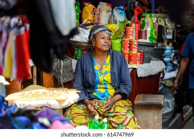 KUMASI, GHANA - JAN 15, 2017: Unidentified Ghanaian woman sells goods at the Kumasi market. Ghana people suffer of poverty due to the bad economy.