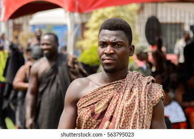 KUMASI, GHANA - JAN 16, 2017: Unidentified Ghanaian man at the memorial ceremony dedicated to the Queen mother of the Asante kingdom, who died on Nov 14, 2016 at the age of 111