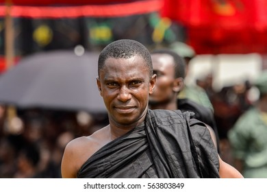 KUMASI, GHANA - JAN 16, 2017: Unidentified Ghanaian man in black clothes at the memorial ceremony dedicated to the Queen mother of the Asante kingdom, who died on Nov 14, 2016 at the age of 111