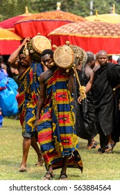 KUMASI, GHANA - JAN 16, 2017: Unidentified Ghanaian musician with a drum  at the memorial ceremony dedicated to the Queen mother of the Asante kingdom who died at the age of 111