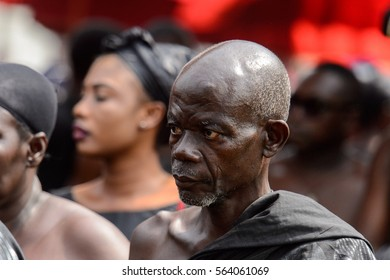KUMASI, GHANA - JAN 16, 2017: Unidentified Ghanaian old man in black clothes at the memorial ceremony dedicated to the Queen mother of the Asante kingdom, who died on Nov 14, 2016 at the age of 111