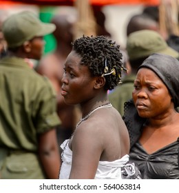 KUMASI, GHANA - JAN 16, 2017: Unidentified Ghanaian woman in white clothes at the memorial ceremony dedicated to the Queen mother of the Asante kingdom, who died on Nov 14, 2016 at the age of 111