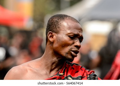 KUMASI, GHANA - JAN 16, 2017: Unidentified Ghanaian musicians in black and red clothes at the memorial ceremony dedicated to the Queen mother of the Asante kingdom, who died  at the age of 111