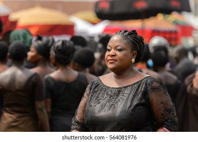 KUMASI, GHANA - JAN 16, 2017: Unidentified Ghanaian woman in black clothes at the memorial ceremony dedicated to the Queen mother of the Asante kingdom, who died on Nov 14, 2016 at the age of 111