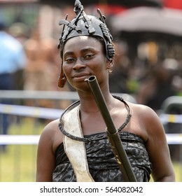 KUMASI, GHANA - JAN 16, 2017: Unidentified Ghanaian woman with a gun in black clothes at the memorial ceremony dedicated to the Queen mother of the Asante kingdom, who died  at the age of 111