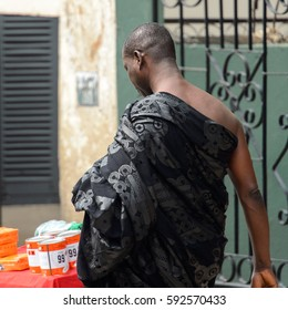 KUMASI, GHANA - Jan 16, 2017: Unidentified Ghanaian man in black clothes from behind. People of Ghana suffer of poverty due to the bad economy