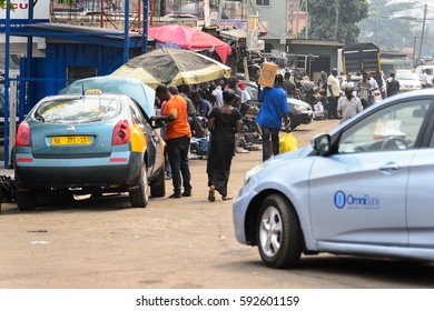 KUMASI, GHANA - Jan 16, 2017: Unidentified Ghanaian group of people walk on the market. People of Ghana suffer of poverty due to the bad economy