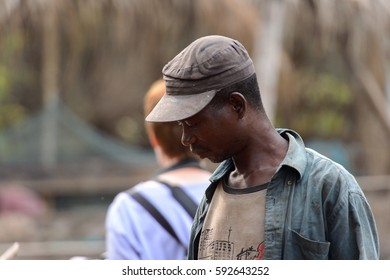 KUMASI, GHANA - Jan 16, 2017: Unidentified Ghanaian man in dirty clothes looks down. People of Ghana suffer  poverty due to the bad economy