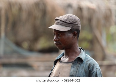 KUMASI, GHANA - Jan 16, 2017: Unidentified Ghanaian man in dirty clothes looks ahead. People of Ghana suffer  poverty due to the bad economy