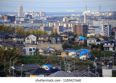 Kumatori, Japan - September 19, 2018: Blue tarps dot roofs damaged when Typhoon Jebi hit the Kansai region in early September