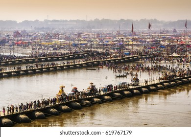 Kumbh Mela festival in Allahabad, Uttar Pradesh, India, crowd crossing pontoon bridges over the Ganges river.