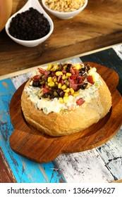 Kumpir - Baked Potato and vegetable in Bread