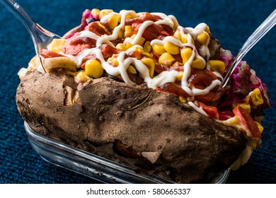 Kumpir / Turkish Baked potato with cheese, corn, sausage, ketchup and mayonnaise.