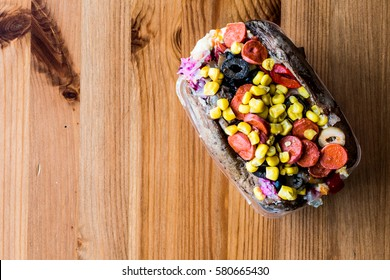 Kumpir / Turkish Baked potato with cheese, corn and sausage copy space.