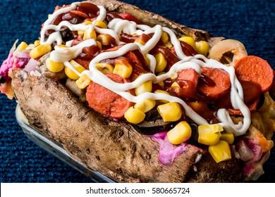 Kumpir / Turkish Baked potato with cheese, corn, sausage, ketchup and mayonnaise.