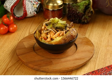 Kumpir - Turkish baked potato with chicken meat, butter, cheese and vegetables