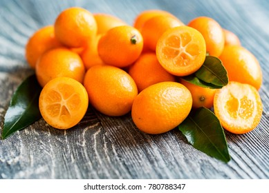 Kumquat or cumquat on wooden table