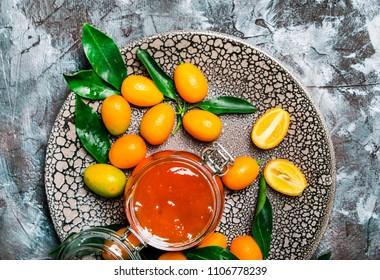 Kumquat jam in a glass jar, top view