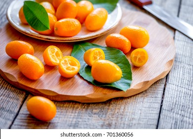 kumquat on plate at wooden table