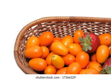 A lot of kumquats and strawberry isolated on the white background