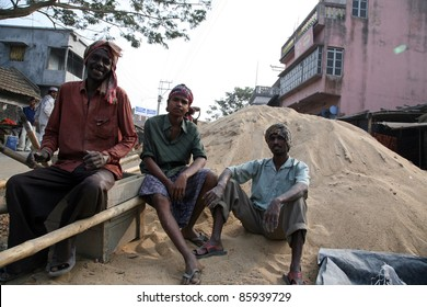 KUMROKHALI, INDIA - JANUARY 12:Men working on construction of new road in Kumrokhali, West Bengal, India January 12, 2009.The tools and materials for the construction of the pots are very rudimentary.