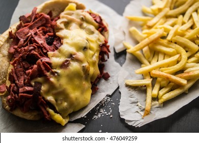 Kumru Sandwich with sausage, ham, melted cheese and potatoes, (Fast food concept.)