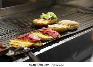 Kumru is a Turkish sandwich on a bun, typically with cheese, tomato, and sausage. The name of this street food translates as collared dove, and derives from the shape of the sandwich. Street Food.