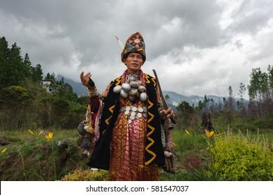 Kundasang Sabah Malaysia - July 3, 2015 :Shaman, Aman Sirom, 62, performing ritual to appease the spirit of Akinabalu, the guardian of Mount Kinabalu.The rituals held after quake hit the mountain.