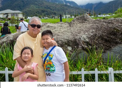 Kundasang, Sabah, Malaysia-May 31, 2018 : Portraiture picture of Happy Grandfather and his grandchild hugging together in the nature farm for happy family activity.