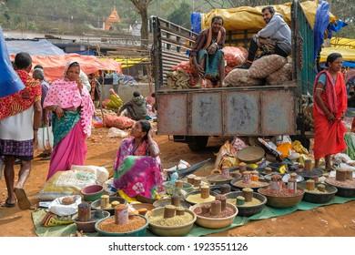 Kunduli, India - February 2021: Women selling vegetables and spices in the Kunduli market on February 19, 2021 in Kunduli, Odisha, India.