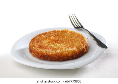 kunefe, kunafeh, traditional dessert with cheese and syrup served warm