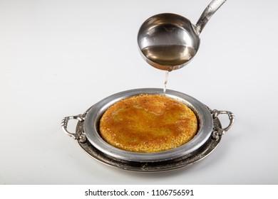 Kunefe with pistachio. Turkish dessert kunefe, with pistachio powder.