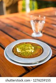 KUNEFE. Traditional Turkish dessert kunefe with pistachio powder.