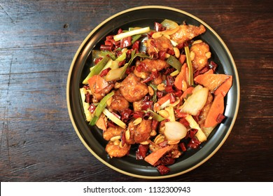 Kung pao Chicken with peanut, shallot, carrot, onion, and red chili a very popular Chinese dish