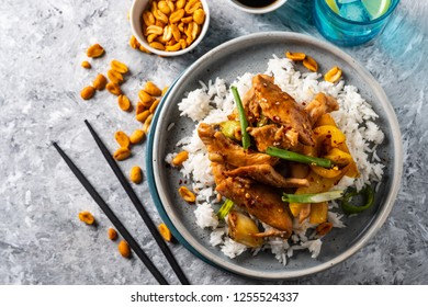 Kung Pao chicken, stir-fried Chinese sichuan traditional sichuan  dish with chicken, peanuts, vegetables and chili peppers.