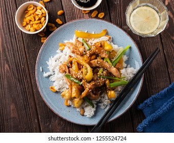 Kung Pao chicken, stir-fried Chinese sichuan traditional sichuan  dish with chicken, peanuts, vegetables, rice and chili peppers.