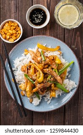 Kung Pao chicken, stir-fried Chinese sichuan traditional sichuan  dish with chicken, peanuts, vegetables and chili peppers. Kung pao chicken rice , chinese food.