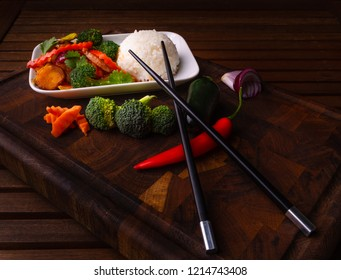 Kung Pao chicken,  also transcribed as Gong Bao or Kung Po.  Is a spicy, stir-fried Chinese dish made with chicken, peanuts, vegetables, and chili. Classic dish in Sichuan Province of south China
