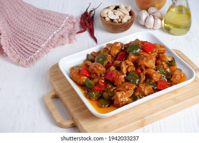 Kung Pao Chicken is typically Sichuan dish is chinese cuisine dish with chicken meat, chilli peppers, peanuts, sauces and onion.