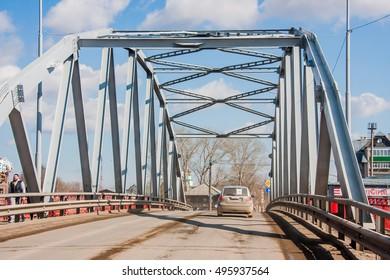 Kungur, Russia - April 16.2016: Automobile bridge through the river Sylva on a background of the blue sky