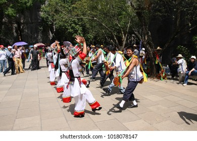 KUNMING, CHINA - 23 April 2009: Women and man performing a traditional marriage dance of the Yi minority in the Yunnan province of China.