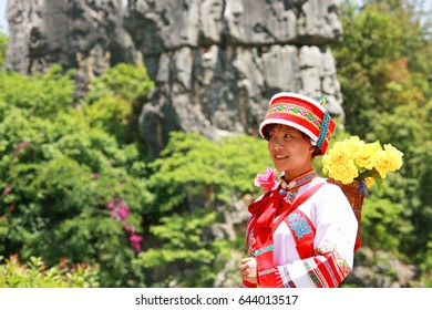 KUNMING, CHINA - 23 April 2009: Woman wearing traditional dress of the Yi ethnic minority of the Yunnan Province in China.
