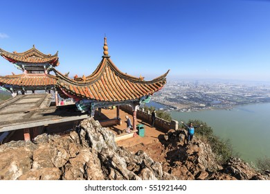 Kunming, China - January 9, 2017: Tourists enjoying the view of Kunming, the capital of Yunnan province in Southern China, from XiShan Western Hill